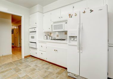 Alternate view of kitchen with oven, gas range, built-in microwave, and included refrigerator!