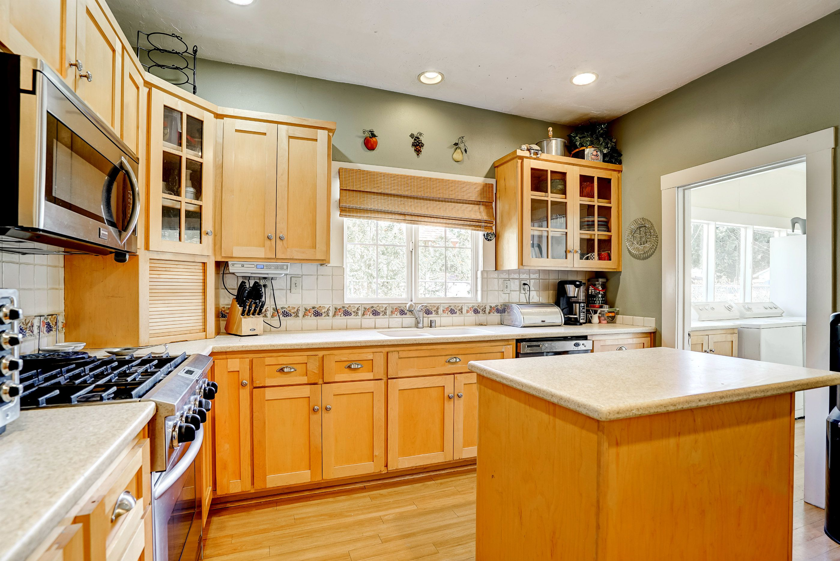 Remodeled kitchen with Corian counters and preparation island.