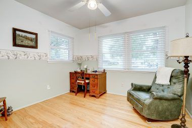 3rd of 4 bedrooms, overlooking the front yard, with hardwood floors and ceiling fan.