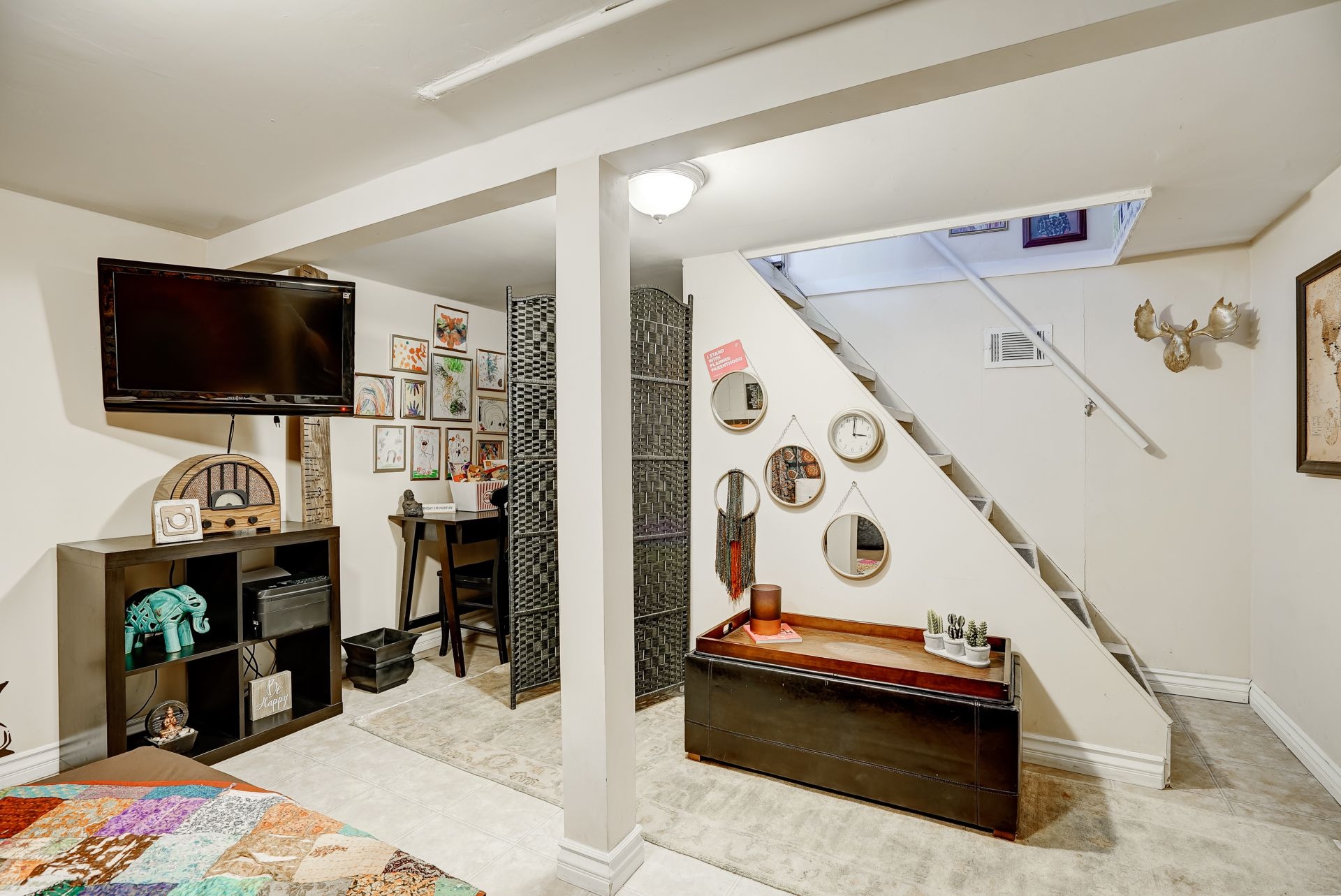 Alternate view of finished basement. Behind the wicker panel is a doorway to another large room for additional storage.