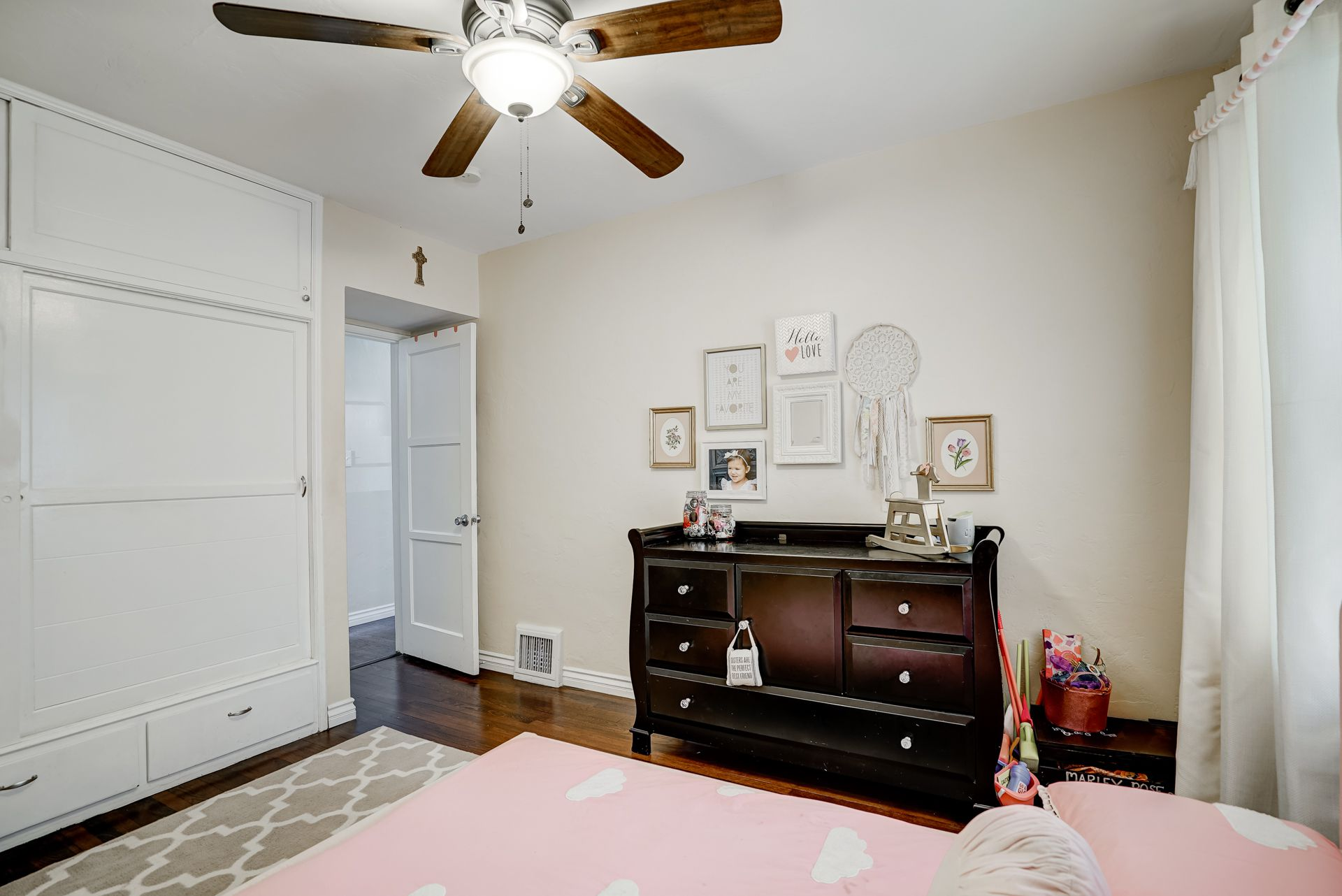 The best part of homes built in this era are the unique closets with extra storage on top and bottom.