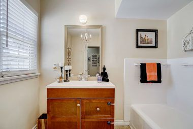Additional full bathroom, with separate shower and tub.