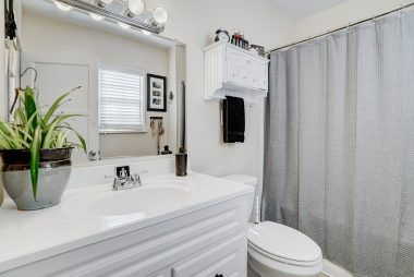 Updated master bathroom with shower in tub.