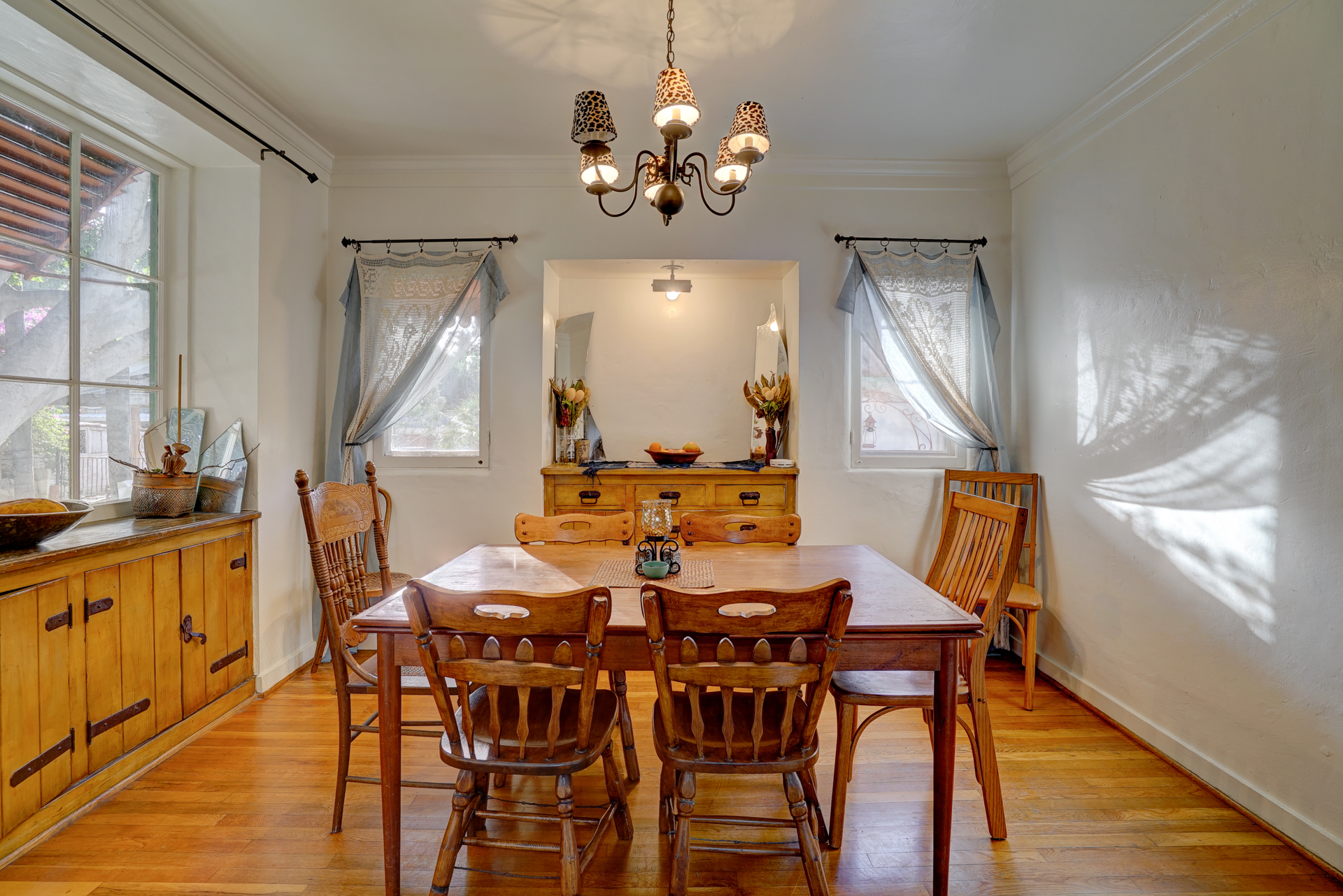 Formal dining room with built-in corner hutch (out of view).