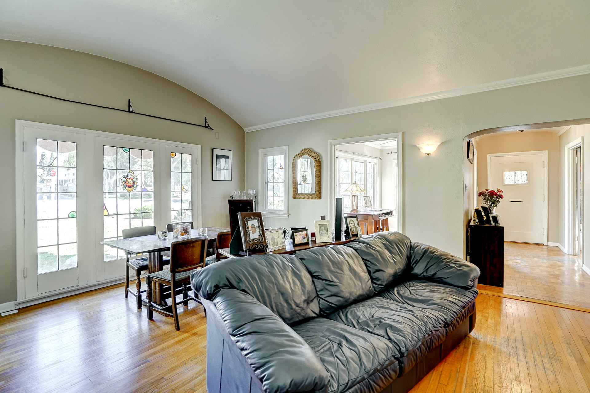 Alternate view of living room into entry hallway and front parlor.
