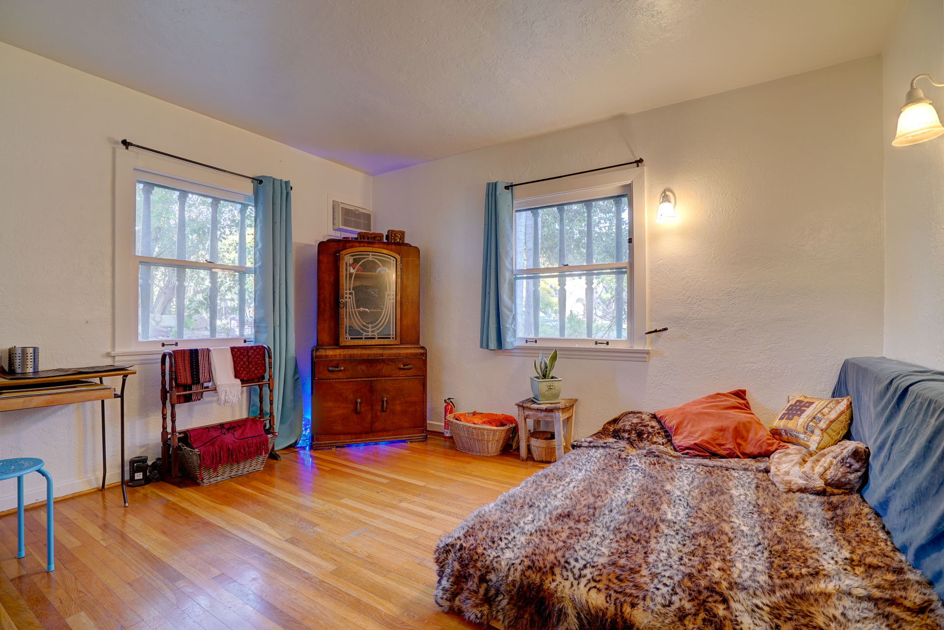 Downstairs bedroom with original hardwood floors.
