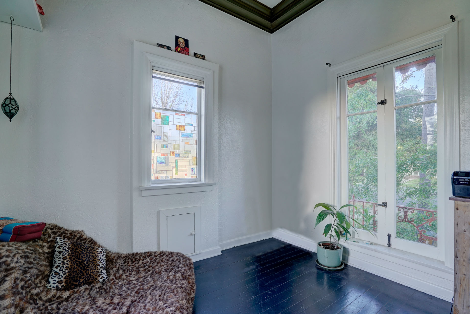 The bell tower room with balcony and wood floors. An ideal room for meditating, reading, or reflecting on who may have stayed in this house during the past 98 years.