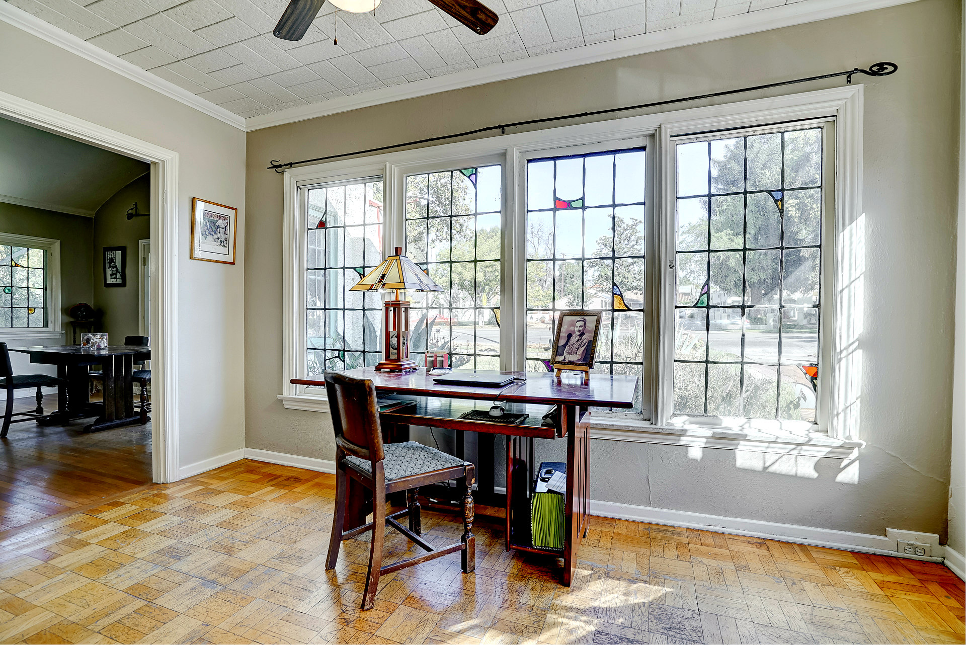 Front parlor or office area with original Jekel themed stained glass window accents.