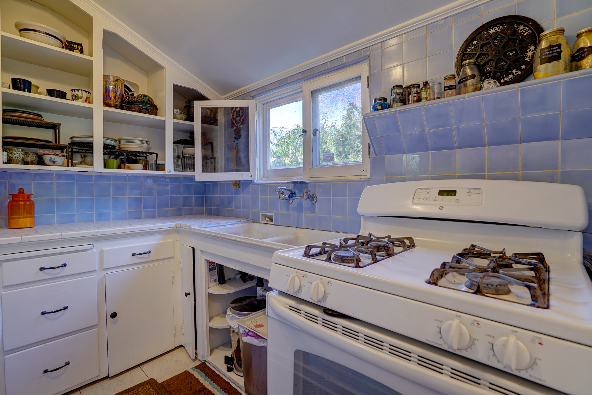Cozy vintage kitchen with gas stove.