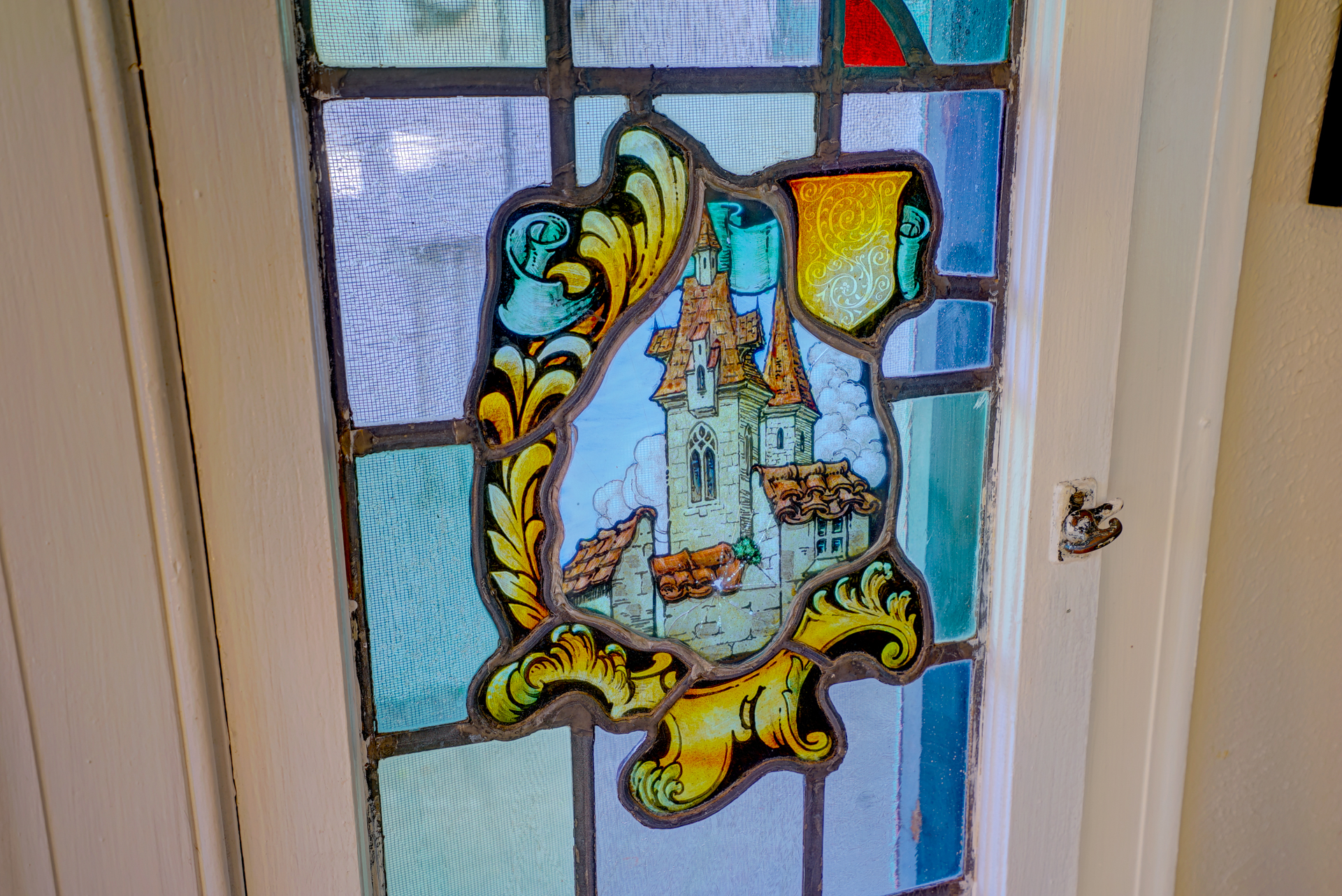 One of the custom stained glass studio windows.