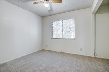 Alternate view of front bedroom. Note that the closet doors have been removed to accommodate a desk, as this room was used as an office or modified back into the 4th bedroom.