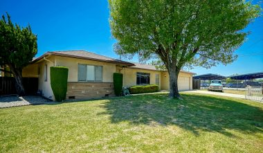 ompletely fenced lot with mature shade trees. Wrought iron in front and block wall around entire back yard.