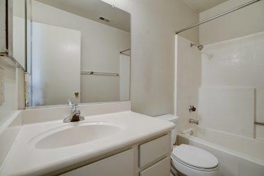 Hallway bathroom with brand new commode.