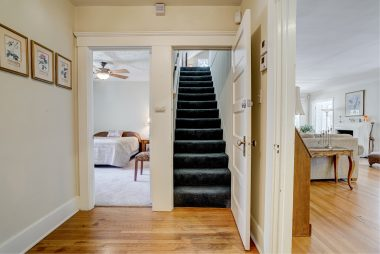 View of hallway leading to middle bedroom and stairway to yet another bedroom and plenty of storage!