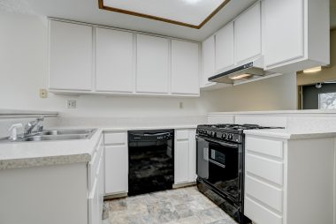 Dishwasher, gas stove, and newer flooring.
