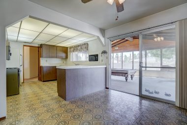 View from formal dining room into kitchen and looking out into the huge bonus room.