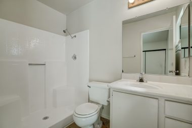 Private master bathroom with walk-in shower.