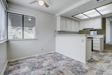 Casual dining nook with breakfast bar overlooking kitchen.
