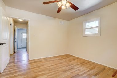 Bedroom #4 with hardwood floors, ceiling fan, and large closet.