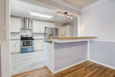 Plenty of room for a formal dining table as well as bar stools for the breakfast bar.