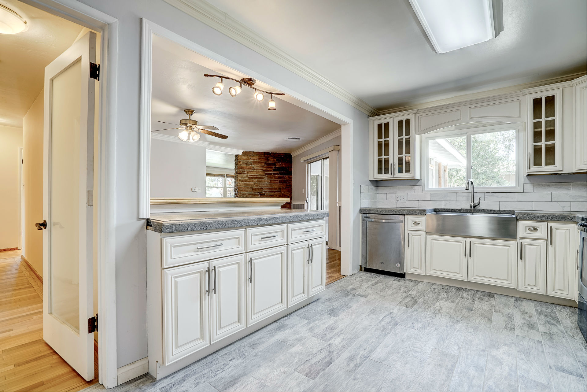 Remodeled Kitchen With Subway Tile Back Splash. Frosted Glass Door Leading  To The Hallway With