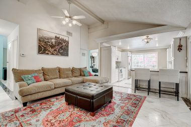 Family room with vaulted ceiling.