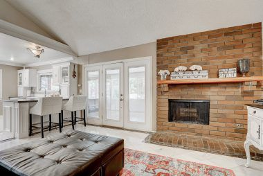 Alternate view of family room with fireplace and French door leading to the bonus room.