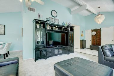 Plenty of wall space in living room for large entertainment center.