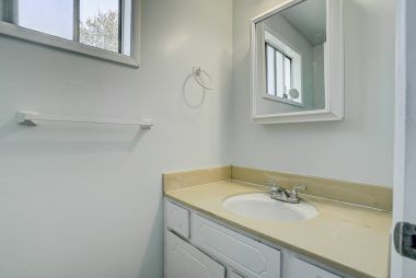 Private half bath off the back bedroom, built and permitted in 1967.