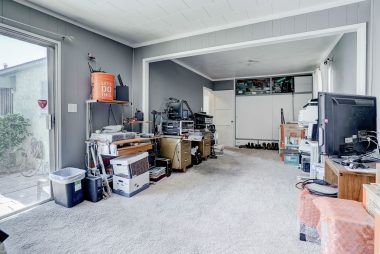 Two bedrooms (each with its own closet) currently being used as one large room. Simply re-build wall or add accordion doors to revert back into two separate bedrooms.