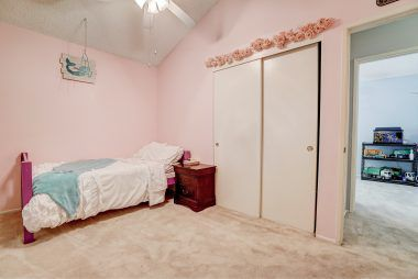 Alternate view of bedroom #2 with vaulted ceiling.