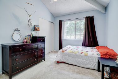 Bedroom #3 with vaulted ceiling.
