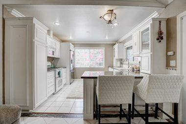 Remodeled kitchen with breakfast bar.