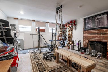 Large basement with fireplace could be used as 4th bedroom or game room or gym.