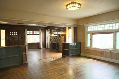 View of formal dining room into living room.