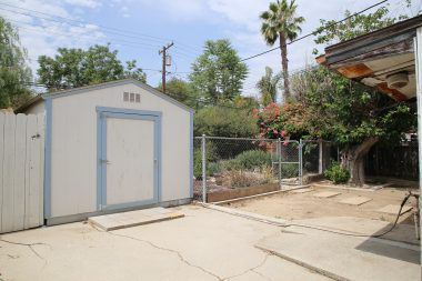 Two back-to-back Tuff Sheds instead of a garage, along with cross-fenced backyard.