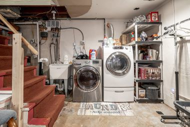 Alternate view of basement with utility sink and laundry area (units included -- washer is only a year old, and seller is unsure of gas dryer age). Laundry elevator eliminates having to walk down the stairs with a basket full of laundry.