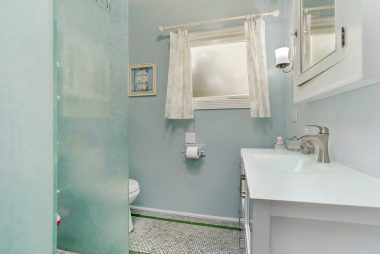 Gorgeous remodeled bathroom with easy no-step walk-in access to the shower.