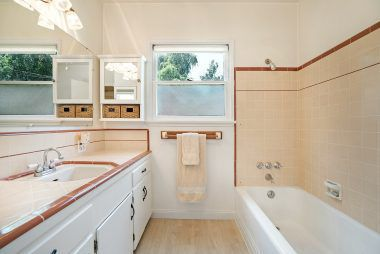 Large vintage bathroom with new flooring.
