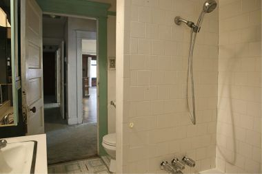 Bathroom with shower in tub.