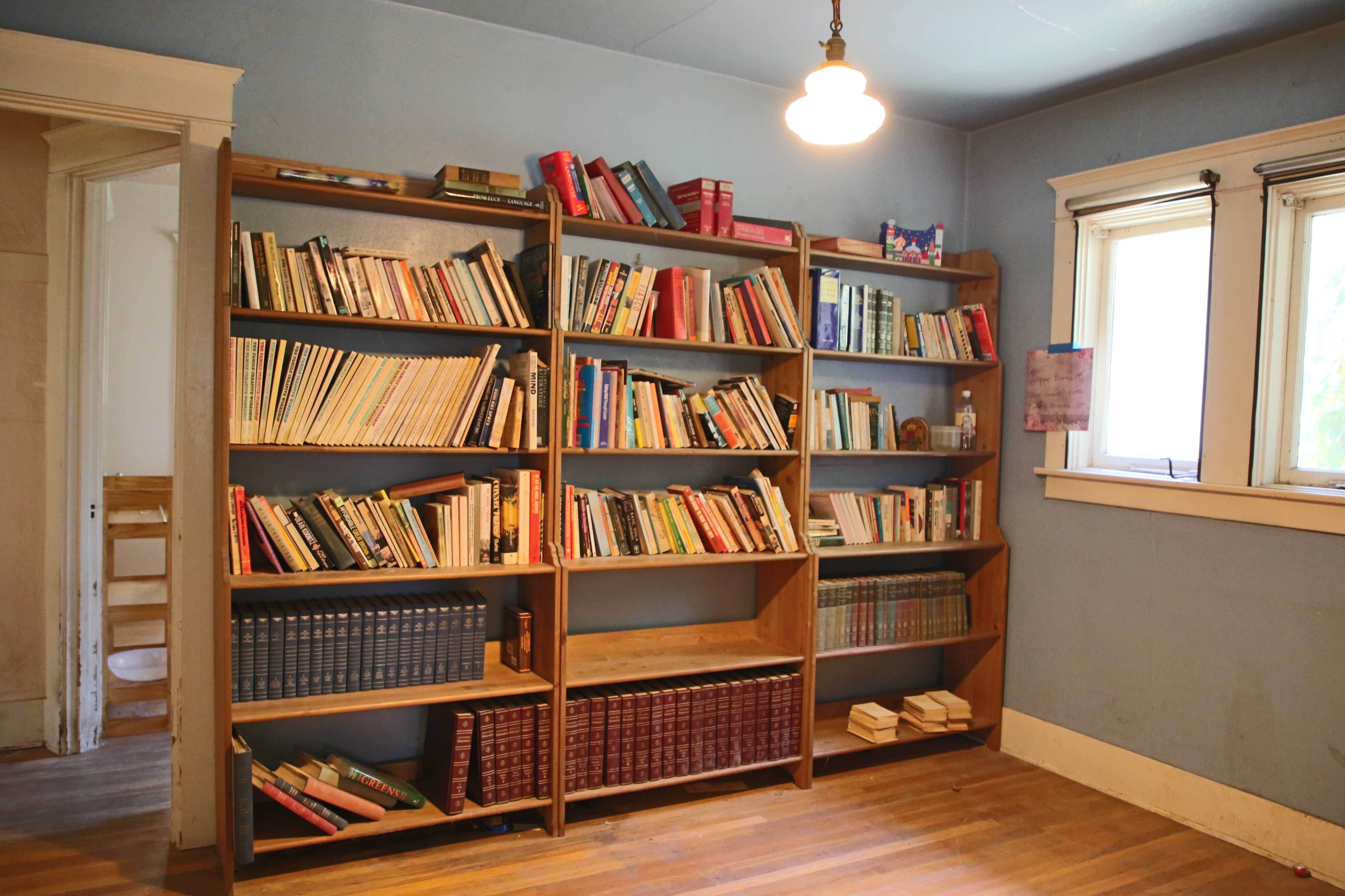 Bedroom #1 with original hardwood floors and walk-in closet.