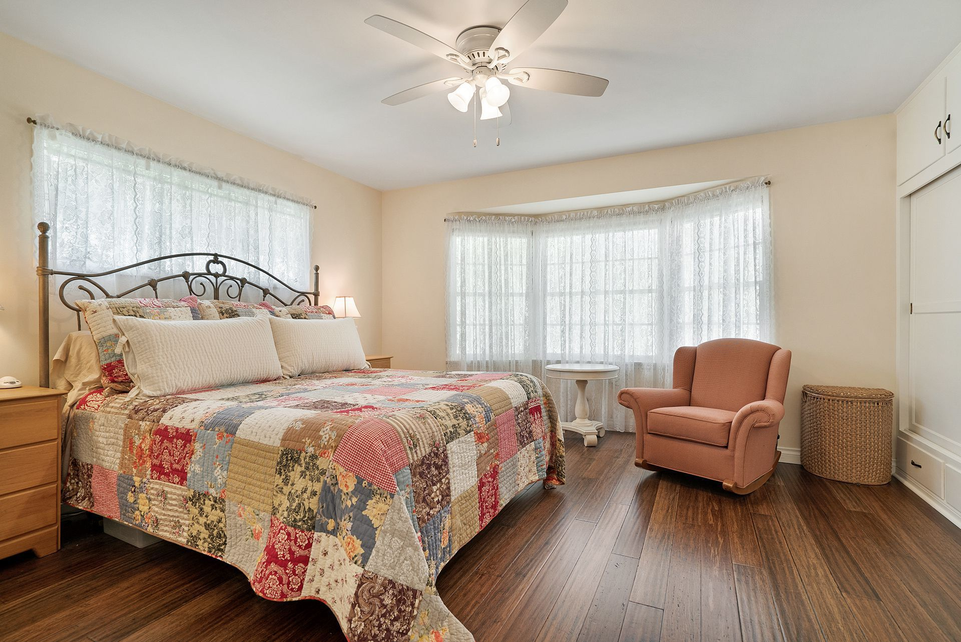 Large Bedroom Overlooking The Back Yard With Bamboo Flooring, Ceiling Fan,  And Two Closets