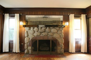 Period lighting flanking the fireplace.