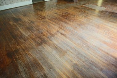 Magnified view of original hardwood floors in the formal dining room.