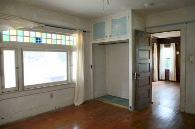 Front bedroom with original windows. Closet doors are missing (might be in attic).