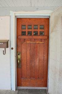 Original front door and hardware (both need some repair).