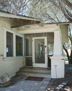 Screened entry to porch. Removing screen door and screens will give this home a more authentic look.