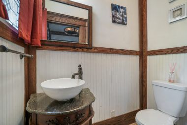 Half bath conveniently located just off the deck for pool guests.