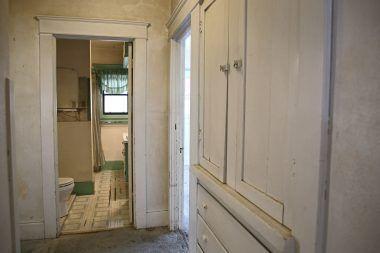 View of hallway linen closet and into bathroom.