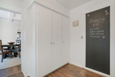 Alternate view of kitchen with large pantry and a fun chalk board for menus or shopping lists.